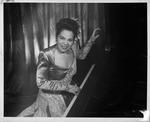 Revella Hughes posing at piano