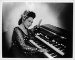 Revella Hughes posing at organ