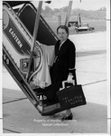 Jean Thomas at Tri-State Airport by Huntington Publishing Company