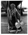 Dagmar Boarding Plane at Tri-State Airport