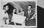 Artist Nicholas deMolas and Group meet to plan Tropical Milk Fund Ball, 1938