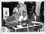 Artist Nicholas deMolas and Group drawing posters for Tropical Milk Fund Ball, 1938