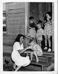 Jane Rovensky giving milk to Helen Finkles, Palm Beach, 1938