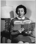 Ann Cutler with her book on Trachtenberg Math System, ca. 1960