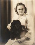 Studio portrait of Rosanna Blake and dog