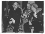 Rev. Father E. J. Flanagan and Mickey Rooney on set of