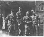 (l to r:) Pfc's Bruce Paulock, Jimmy Hetzer, Mickey Rooney, Unidentified, Germany, 1945