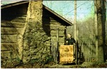 Jean Thomas in front of pioneer schoolhouse, Ashland, Ky