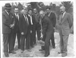 Groundbreaking for building, Ken Hechler with shovel