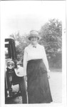 Catherine Bliss Enslow standing beside a Model T Ford