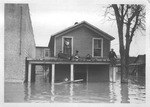 Family marooned on roof, west end of Huntington, 1937 flood