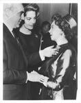 French Ambassador presenting award to Elizabeth Arden