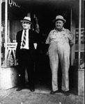 Unidentified men outside Huntington drug store, ca. 1920