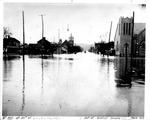 20th St. Baptist Church, and Sixth Ave. Church of Christ,5th Ave. and 20th St., facing river, north,1913 Flood