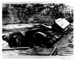 Overturned train engine and washout of railroad tracks following 1913 Flood