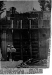 Newspaper photo of workmen at site of East Lynn Dam outlet works building