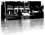 men unloading supplies to boat, Huntington,WVa