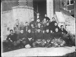 Salem College football team, 1916, Cam henderson seated with ball