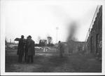 Cam Henderson, Red Crist, George Nilan outside Fairfield Stadium, ca. 1950