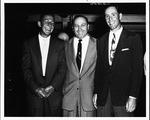 Marshall coach Jules Rivlin (center) with player Walt Walowac (left) ca. 1955