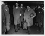 Marshall coaches returning from National basketball championship 1947
