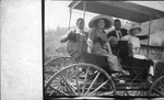 Cam Henderson and Bertha Ash in front seat, ca. 1910