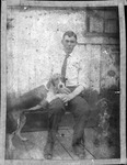Cam henderson with dogs, ca. 1910