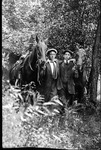 Harlan Bailey and Kline Ralston with horses, ca. 1910-1919