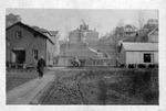 City scene, probably Salem, W.Va. with school on hill, ca. 1910