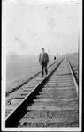 Unidentified railroad brakeman beside tracks