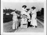 4 unidentified girls at railroad platform, ca. 1910