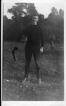 Cam Henderson with football, ca. 1910