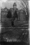 Cam Henderson in front of building at Waynesburg College, 1917
