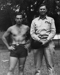 Cam Henderson (right) and Sam Clagg on Marshall practice field, 1946
