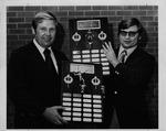 Marshall football coach Jack Lengyel (left) presenting Henderson awards,1972