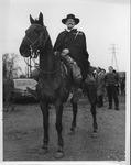 Rev. Sidney Dillenger on horseback, Kenova, WV, 1966