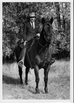 Rev. Sidney Dillenger on horseback, McCracken, Kan., 1966