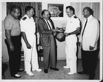 Lt. Paul D. Butcher receives key to Florida cities, Dec. 1962
