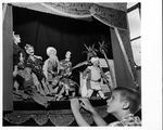 Unidentified boy viewing Chinese opera puppets, 1959