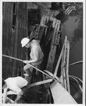 Clearing wreckage at the David Brinkley bridge, Wayne, WV, Sept. 1970,