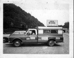 Pickup truck with campaign sign for reelection of WV Gov. Arch Moore, ca. 1970's