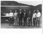 Group of men & biplane at Chesapeake, Oh airport, 1929