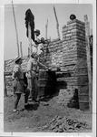 Frank Vandergrift supervising construction of industrial missionary church, 1958