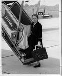 Jean Thomas, boarding airplane at Huntington Tri-State Airport, 30 July 1957