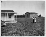 Jesse Stuart & wife Deane survey their 800 acre farm, ca. 1950's,