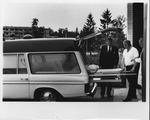 Dr. Carl Hoffman examining ambulance at Flen Rural health Ctr., Sweden