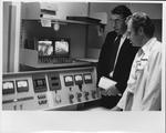 Dr. Carl Hoffman examining equipment, Karolinska Hospital, Stockholm
