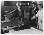 Dr.Ernst Fromm explains medical equipment to Dr. Carl Hoffman, Hamburg Hosp