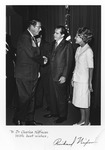 Dr. Carl Hoffman shaking hands with Pres. Richard Nixon, autographed by Nixon