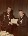 Dr. Charles Hoffman presenting certificate to Dr. William P. Didusch, 1968